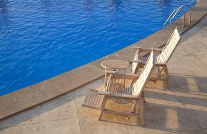 Photo Margelle de piscine en Travertin Light mix